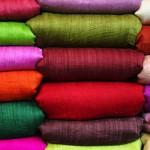 Как выбрать ткань для пошива женской одежды